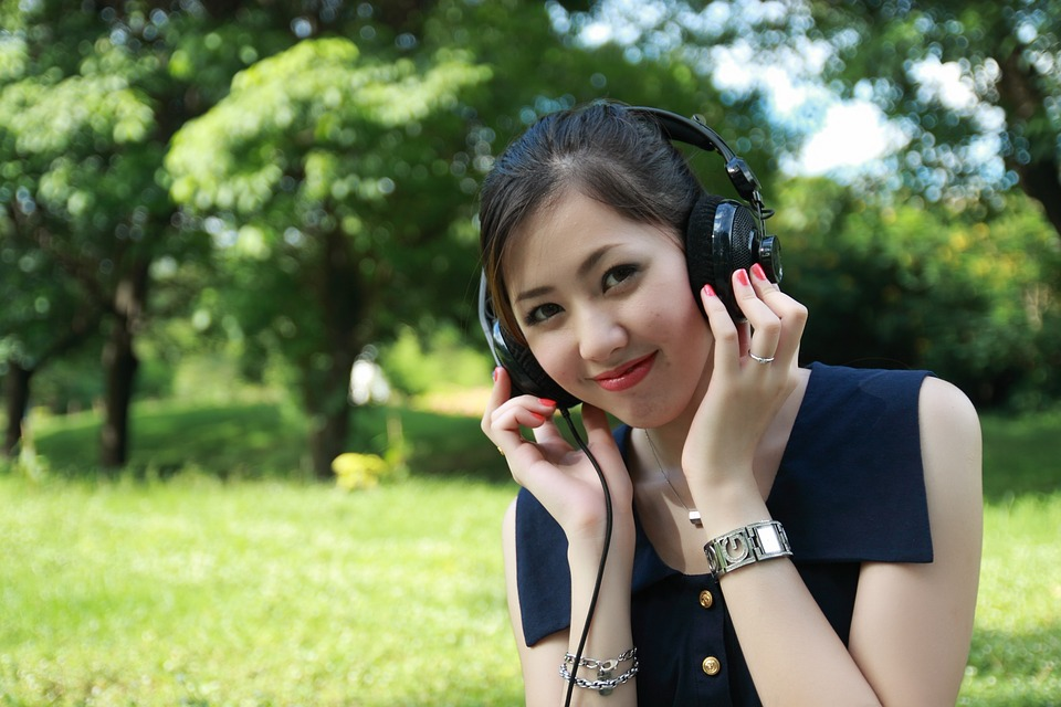 Smiled Girl Listening to Music