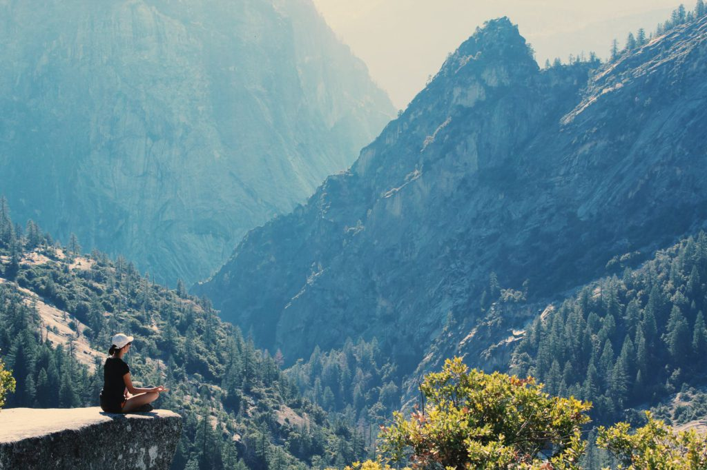Woman Practicing Meditation in Mountains